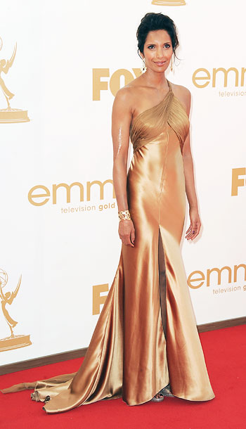 Padma Lakshmi | We can appreciate the flattering color choice of the Top Chef host's Armani Prive dress, but not its overly monochromatic effect. B-