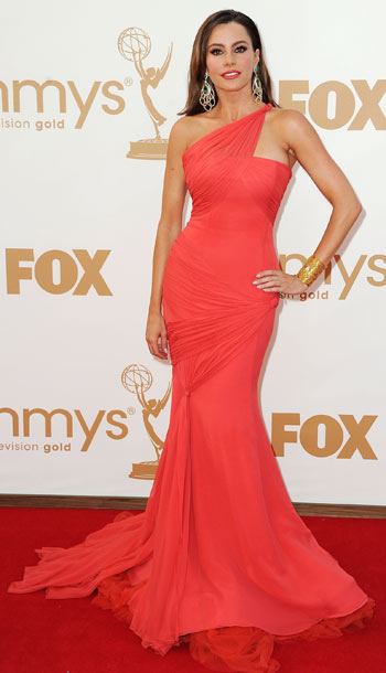 Sofia Vergara | Though the earrings teetered on overkill, they couldn't take away from her expertly draped coral Vera Wang gown. B