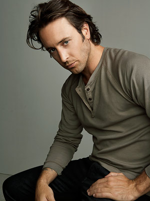 Alex O'Loughlin | With his longish hair, chiseled facial features, and strategically unbuttoned shirt, the Moonlight star looked like he could have graced the cover of a romance…