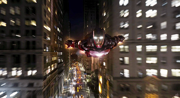 Iron Man flies through New York city canyons. We've seen him soaring through deserts and up into the stratosphere, but it's cool to see him…
