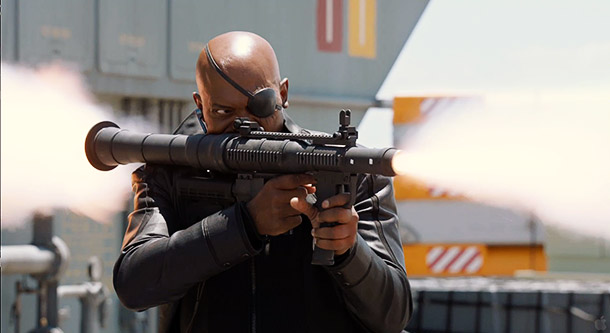 Nick Fury shoots a rocket launcher at somebody. Something tells me that rocket has ''Bad Mother F---er'' written on it.