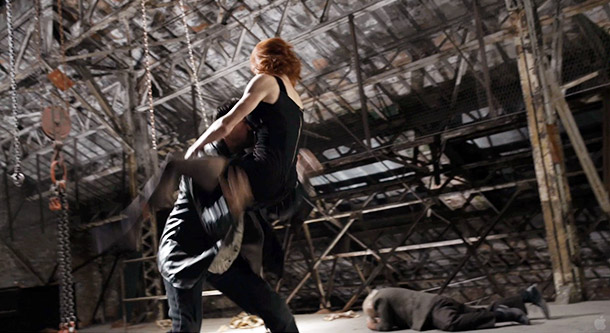 Thigh grab! Scarlett Johansson's Black Widow wraps her legs around some villain's face for a throwdown. He's surely thinking: All things considered, not the worst…