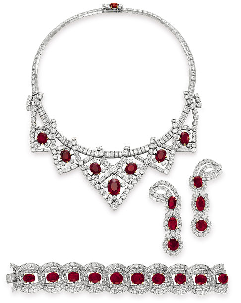 A ruby and diamond necklace, a pair of ruby and diamond ear pendants, and a ruby and diamond bracelet, all from Cartier. Estimated value: necklace,…