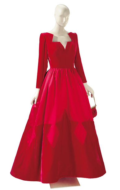 A Valentino red velvet and satin ball gown with scarlet and beaded satin evening bag. Estimated value: $3,000-$5,000