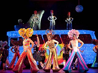 Nick Adams, Will Swenson | PRISCILLA QUEEN OF THE DESERT (Left to right) Will Swenson, Tony Sheldon, and Nick Adams in Broadway's latest jukebox musical extravaganza, based on 1994 movie…