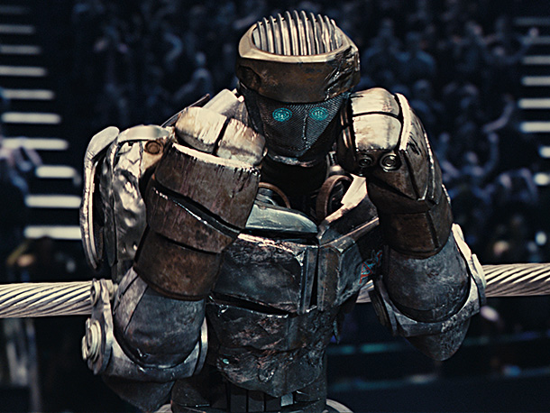 Real Steel | Atom is the hero of this story, the battered, discarded training bot that Hugh Jackman's washed-up fighter, Charlie Kenton, and his estranged son Max (Dakota…