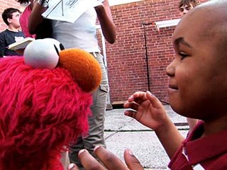 LOL Elmo (Kevin Cash) putting smiles on kids faces in Being Elmo: A Puppeter's Journey