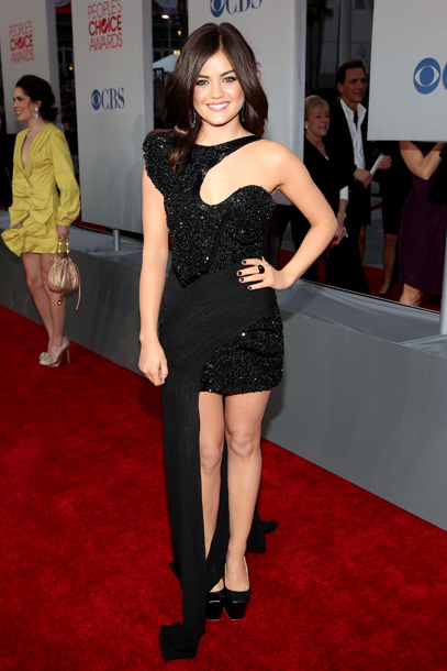 Lucy Hale, People's Choice Awards | Though we don't mind Lucy's shimmery little black dress, it's the drape hanging off the side we just can't seem to look past. C