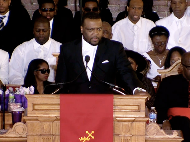 Pastor Joe Carter of the New Hope Baptist Church, where Houston grew up and where the service took place, also took to the podium