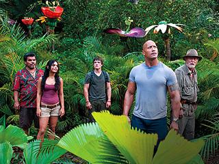 MYSTERIOUS MAYHEM Luis Guzman, Vanessa Hudgens, Josh Hutcherson, Dwayne Johnson, and Michael Caine in Journey 2: The Mysterious Island