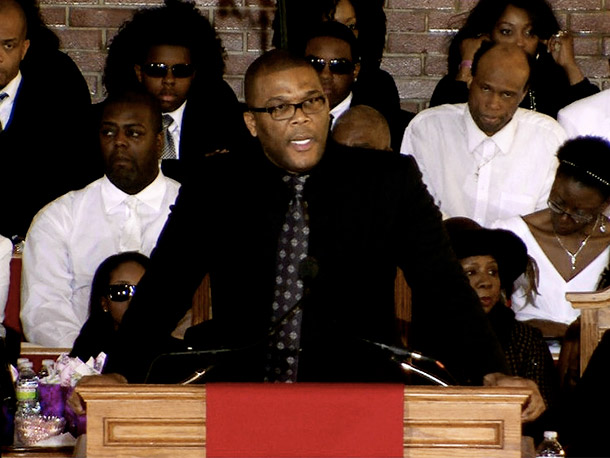 """Tyler Perry brought a passion to the podium as he talked of """"a grace that carried"""" Houston through life"""