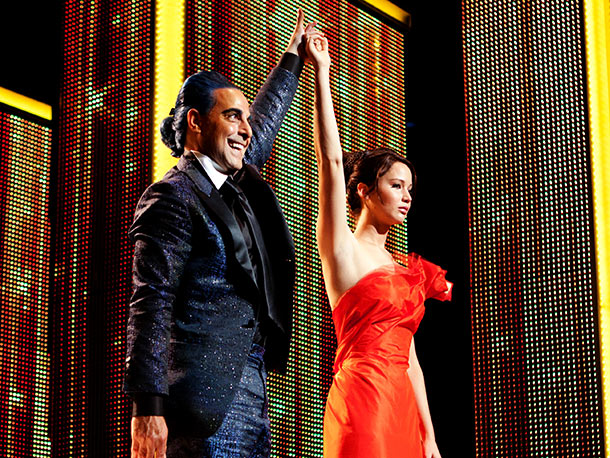 The Hunger Games, Jennifer Lawrence, ... | For Katniss' interview with Caesar Flickerman (Stanley Tucci), Makovsky also deviated a bit from Suzanne Collins' text. ''In the book, it's described as being covered…