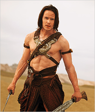MARS INVASION Taylor Kitsch fights against vicious creatures in John Carter