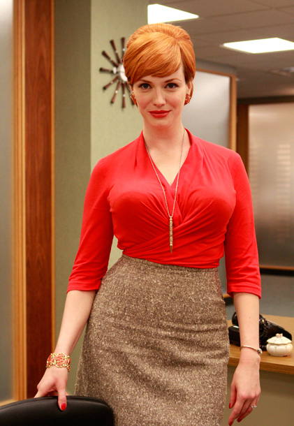 Mad Men, Christina Hendricks | With a rouge-red shirt that matches her rouge-red lips, which in turn matches her rouge-red earrings, which almost perfectly aligns with her cherry-blond hair —…