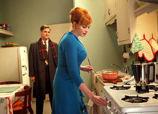 Mad Men, Christina Hendricks | This sky-blue number symbolize two of Joan's internal instincts: The urge to escape from the boxed-in nature of her domestic and professional existence into the…