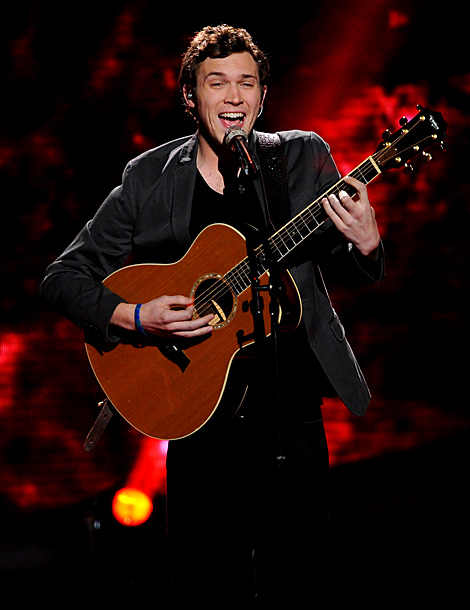 I'd love for him to do something down tempo and acoustic, or even take on a female-sung tune (or two) this week. Why not? Kid…