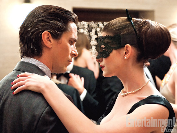 The always debonair Bruce Wayne dances with Selina Kyle (Anne Hathaway) at a lavish masquerade ball. Director Christopher Nolan's interpretation of Kyle is an enigma,…