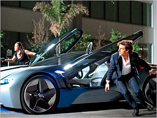 SMOOTH RIDE Paula Patton and Tom Cruise in Mission: Impossible — Ghost Protocol