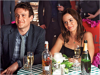 NOT ON TRACK Jason Segel and Emily Blunt pay an adorkable couple who can't seem to tie the knot in The Five-Year Engagement