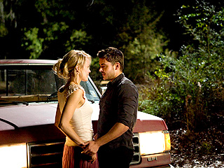 FALSE PRETENSES Zac Efron and Taylor Schilling fall in love in Nicholas Sparks romantic drama The Lucky One