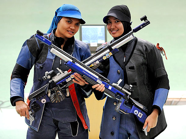 Summer Olympics 2012 | Shooting, Women's 10m air rifle The 29-year-old Malaysian shooter (left) won't be the first pregnant woman to compete in an Olympics when she takes aim…