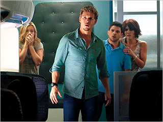 DOOMED FLIGHT Amy Smart, Ryan Kwanten, Jerry Ferrara, Nicky Whelan, and Scout Taylor get spooked in 7500