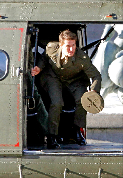 Nov. 26: Tom Cruise arrives to the set of All You Need Is Kill in London's Trafalgar Square aboard an RAF helicopter (photo taken Nov. 25)