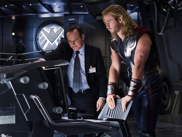 Agent Phil Coulson (Clark Gregg) and Thor (Chris Hemsworth)