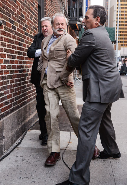 Dec. 7: Bill Murray ''escorted'' into N.Y.'s Ed Sullivan Theater for ''Late Show with David Letterman'' appearance (photo taken Dec. 6)