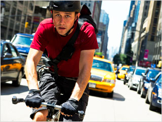 BIKING BONANZA Joseph Gordon-Levitt cycles away from trouble in Premium Rush