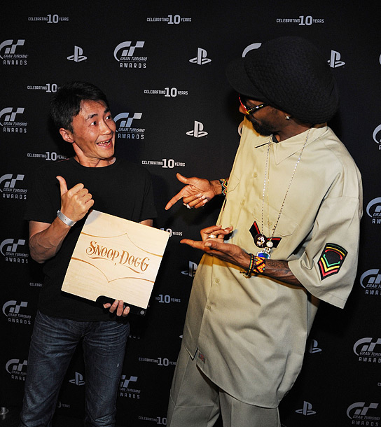 Nov. 2: ''Gran Turismo'' game creator Kazunori Yamauchi and Snoop Dogg at PlayStation's 10th Annual Gran Turismo Awards in Las Vegas (photo taken on Nov. 1)