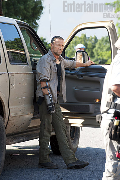 The Walking Dead | Fans of the show will recognize Merle Dixon (Michael Rooker), whom we ?last saw on a roof with his wrist handcuffed to a pipe back…