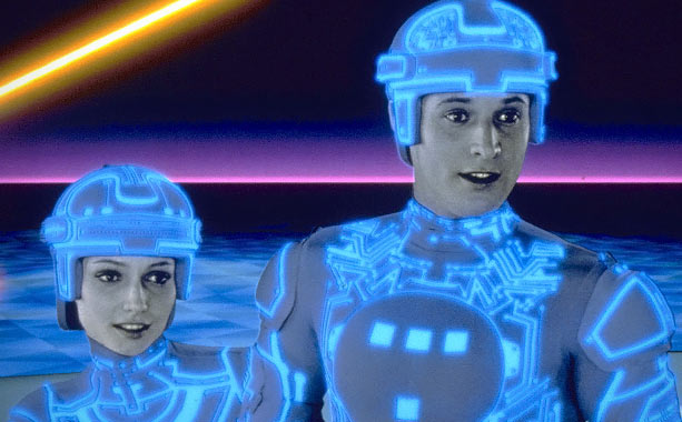 Tron | Disney painted with pixels in their visionary early deployment of CGI about a genius computer programmer (Jeff Bridges) trapped inside a dystopian cyberspace lorded over…