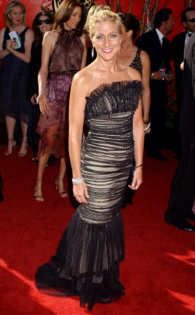 Edie Falco | It's usually quite hot on the Emmy red carpet, but that doesn't mean the Sopranos star had to wear a fan. Someone should have taken…