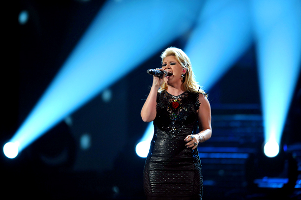 The original Idol proudly bore the number 2311 — a reference to her American Idol audition number — as she sang in front a panel…