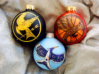 Price: $50.00 on Etsy Your family is sure to break out in the mockingjay call once they catch sight of these hand-painted ornaments. — Maane…
