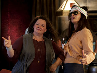 PACKING 'HEAT' Sandra Bullock teams up with Melissa McCarthy to fight crime in The Heat