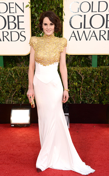 Golden Globe Awards 2013 | From Downton Abbey to the red carpet, the actress channeled Lady Mary in a fall 2012 couture gown with a regal gold guipure bodice. I…