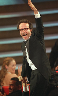 Oscars 1999, Roberto Benigni | We suppose that if Sophia Loren shouted our name with such élan, we'd jump out of — and on top of — our chairs. Sure,…