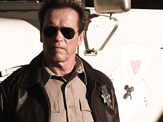 'STANDING' TALL Arnold Schwarzenegger defends his small town from a drug-cartel