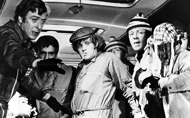 The Italian Job (Movie - 1969) | THE SETUP Charlie (Michael Caine), freshly released from prison, gets funding from a faiBOLD underworld boss (Noel Coward) and enlists help from a gang that…