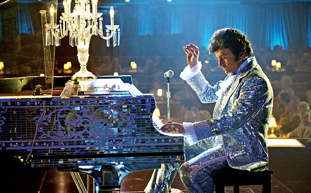 BEHIND THE CANDELABRA Liberace (Michael Douglas) tickles the ivories