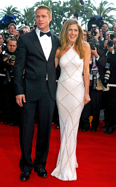 Style, Style: Red Carpet, ... | In 2004, Jennifer Aniston dazzled in an embellished Atelier Versace gown halter dress when she accompanied then-husband Brad Pitt to the premiere of Troy .