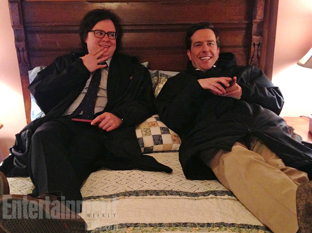 Clark Duke (Clark) and Ed Helms (Andy) relax in between scenes at a ''remote location,'' Fischer teases. ''The bed was the coveted place to wait,…