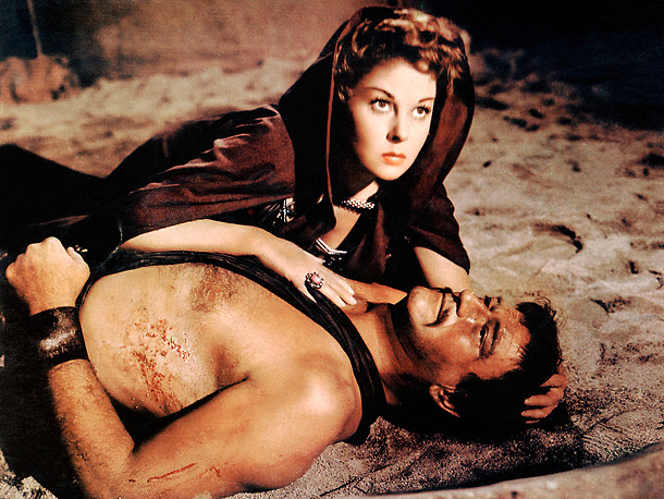 John Wayne, Susan Hayward | While most of these films are examples of catastrophes taking place during a production, the tragedy of The Conqueror only revealed itself in retrospect. John…
