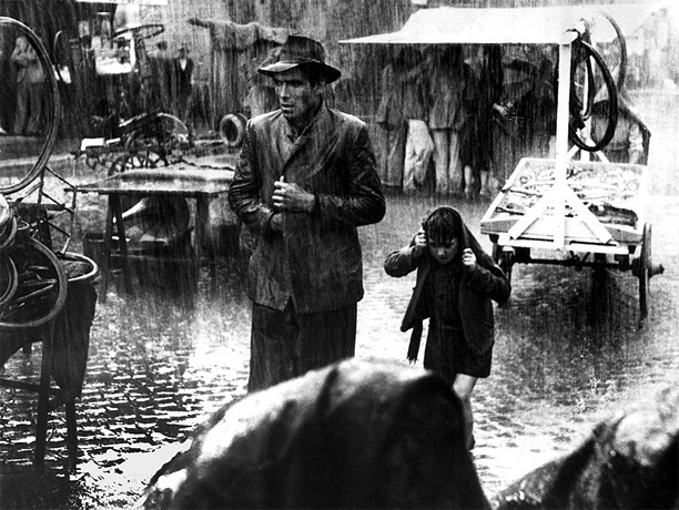 Directed by Vittorio De Sica A workingman and his son look for the father's stolen bicycle in De Sica's gloriously simple story, the essential specimen…