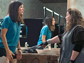 Movie Guide, Sandra Bullock, ... | IT'S GETTING HOT IN HERE Melissa McCarthy gives Sandra Bullock a wardrobe adjustment in The Heat
