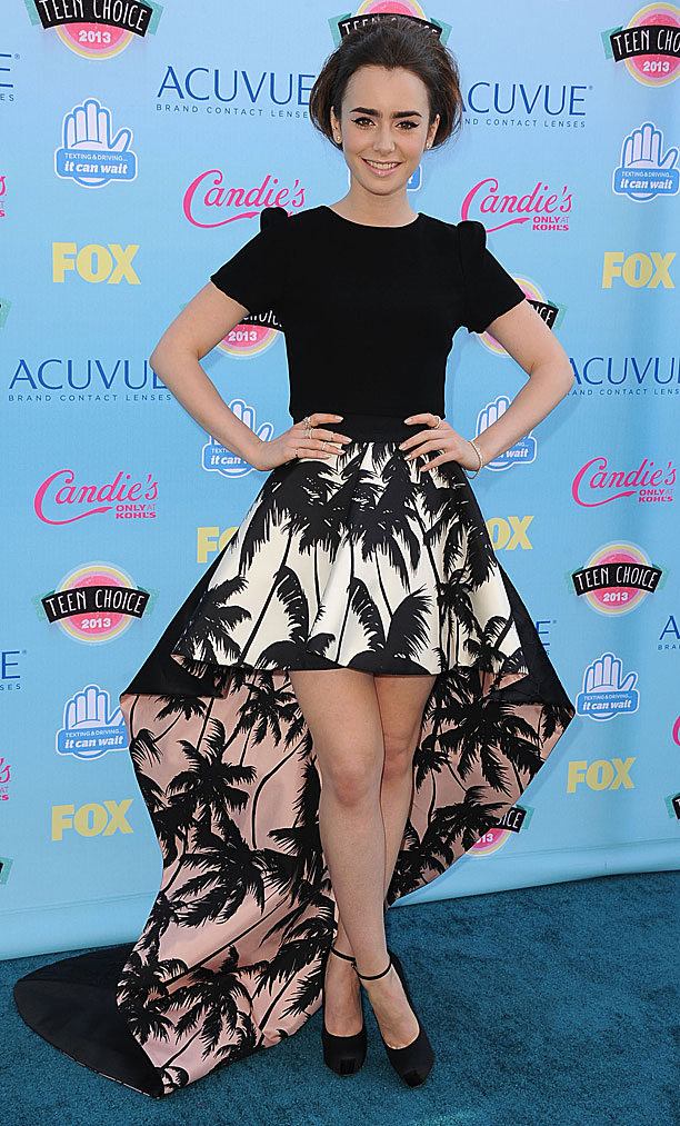 Lily Collins (in Houghton top, Fausto Puglisi skirt)