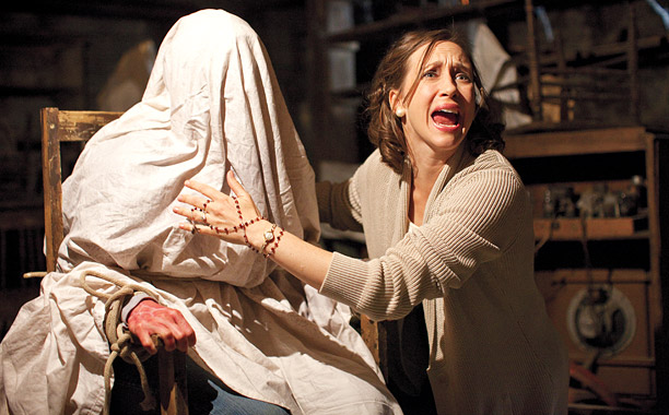 LAZIEST HALLOWEEN COSTUME EVER Vera Farmiga yells while an anonymous demon sits strapped to a chair in The Conjuring