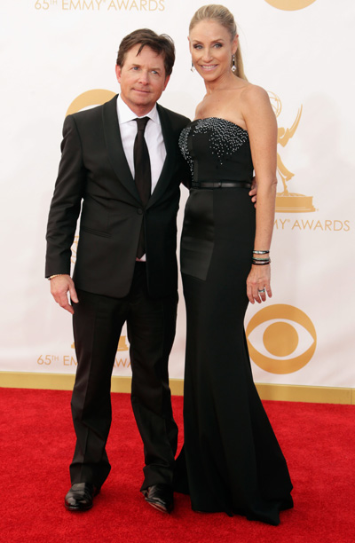Michael J. Fox in Emporio Armani and Tracy Pollan